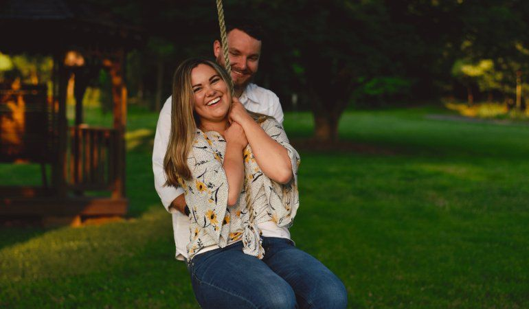 husband and wife on a swing